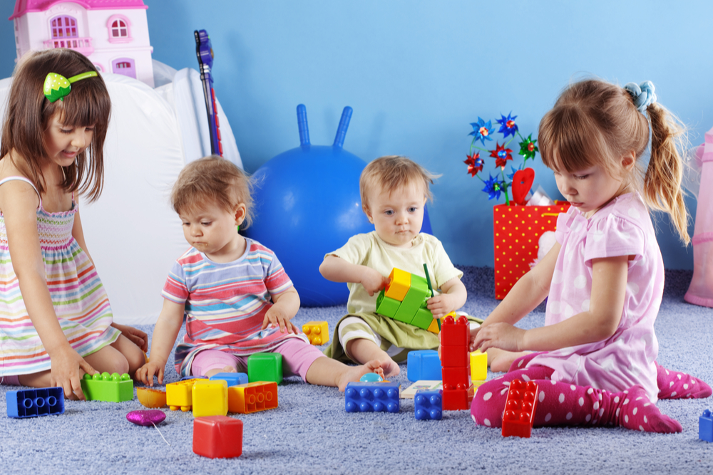 children using building blocks indoors at a childcare centre